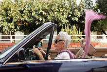 Old Woman Driving A Convertibl...
