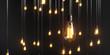 Leinwandbild Motiv viele Edison Glühbirnen hängen im Raum und leuchten mit warmem Licht