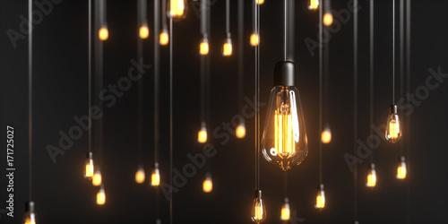 Photo  viele Edison Glühbirnen hängen im Raum und leuchten mit warmem Licht