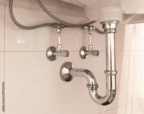 Fotografie, Tablou Basin siphon or sink drain in a bathroom