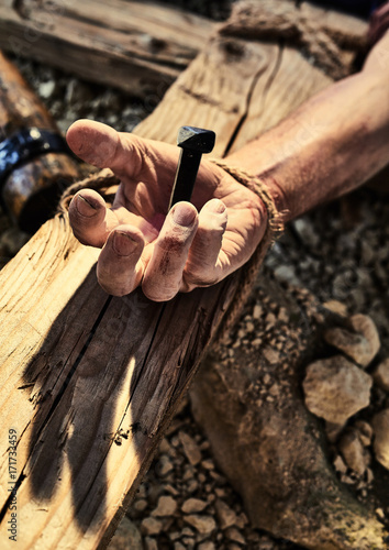 Close up of human hand nailed to cross Canvas Print