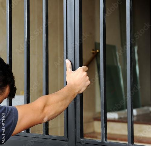 Fotografie, Obraz  Blacksmith placing a new entrance door to the building