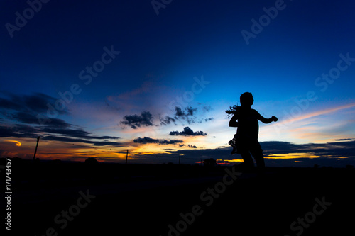 Poster UFO Silhouette of woman posing at sunset or sunrise
