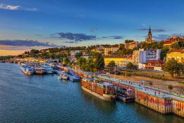 Sunset over Belgrade and ships in the harbor. HDR image
