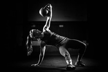 Woman Athlete Exercising With ...