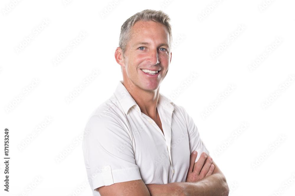 Fototapeta Portrait of confident mature man standing on white background
