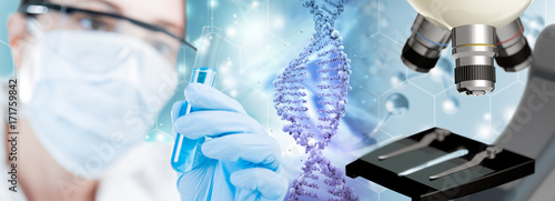 Photo scientist, DNA helix and microscope in blue background