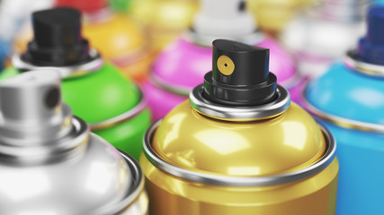 Colored spray paint cans closeup