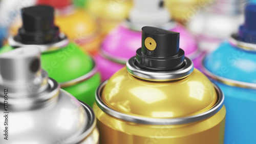 Colored spray paint cans closeup © Oleksandr Delyk