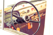 Vintage Car Steering Wheel And Dashboard Cabin View
