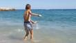 Two boys in diving mask splashing in sea waves - 4K