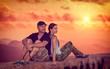 Beautiful couple enjoying sunset