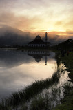 Beautiful morning near the lake, fog cover the hill, reflection and lightiing from the mosque - 171812807
