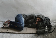 Homeless Woman Sleeping On The...