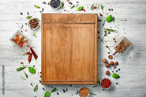 Papiers peints Herbe, epice 2 Composition with wooden board, spices and herbs on table