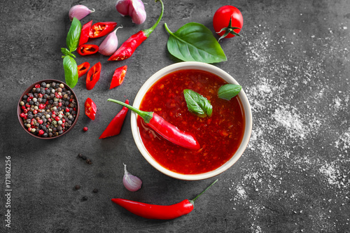 Canvas Prints Hot chili peppers Composition with chili sauce in bowl on table