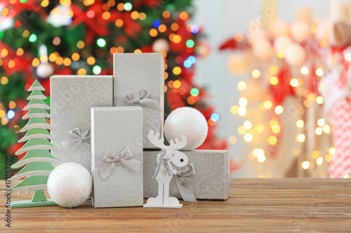 Gift Boxes And Christmas Decorations On Table Against Blurred
