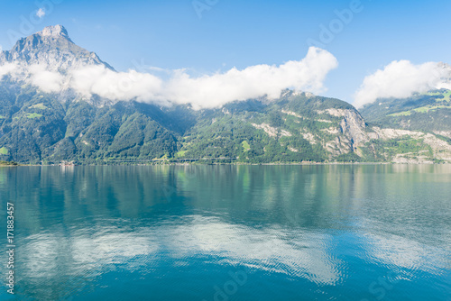 Foto auf Gartenposter Reflexion Сumulus cloud. Stratocumulus clouds in the Alps mountains. Reflected in the water of Lake Lucerne.