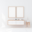 Two Wooden poster Frames hanging on the white wall in modern interior. 3d rendering