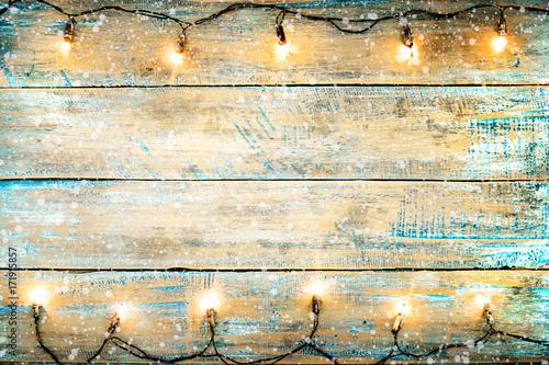 Christmas lights bulb on wood table Canvas Print