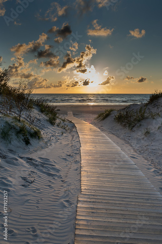 Path to Baltic sea in sunset time, Liepaja, Latvia. Wall mural