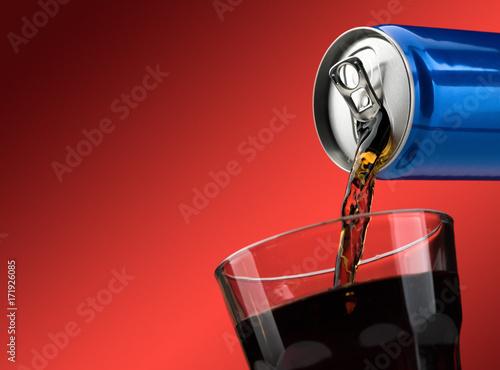 Obraz na plátně  Pouring a soft drink in a glass