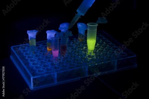 Fluorescent solutions in vials Canvas Print