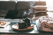 canvas print picture - Tea with steam in room in morning sunlight