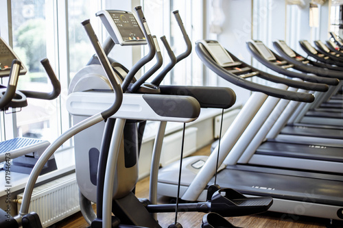 Equipment and machines at the modern gym room fitness center buy