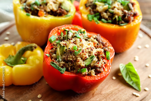 Fototapeta Quinoa stuffed peppers on wooden board obraz