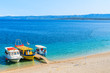 Tourist boats on beautiful Zlatni Rat beach in Bol town, Brac island, Croatia