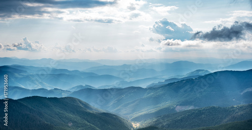 Photo Stands Blue jeans Mountain landscape with sun beams in ukrainian Carpathiaan