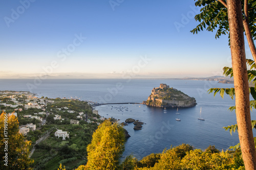 Fotomural  Aerial scenic view on Aragonese fortress at sunset, Ischia, Italy