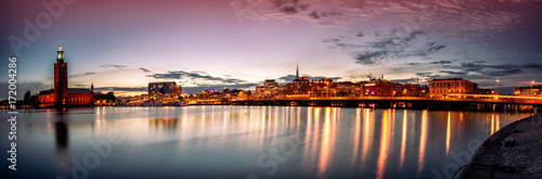 Poster Stockholm Stockholm sunset skyline with City Hall as seen from Riddarholmen. Panoramic montage from 13 images