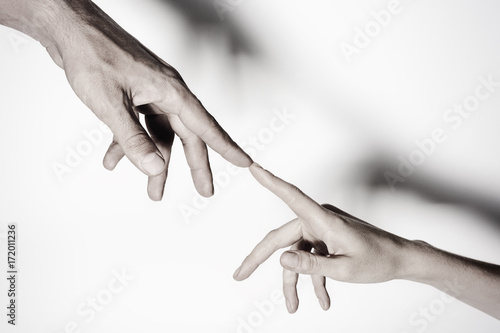 Fotografie, Obraz  Male and female hands connected with each other together and forever