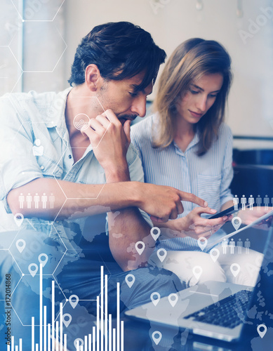 Concept of digital diagram,graph interfaces,virtual screen,connections icon.Teamwork process.Young business people working with new startup project.Blurred background.Vertical. Wall mural