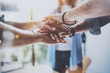 canvas print picture - Teamwork business concept.Close up view of group of three coworkers join hand together during their meeting. Horizontal.Blurred background.