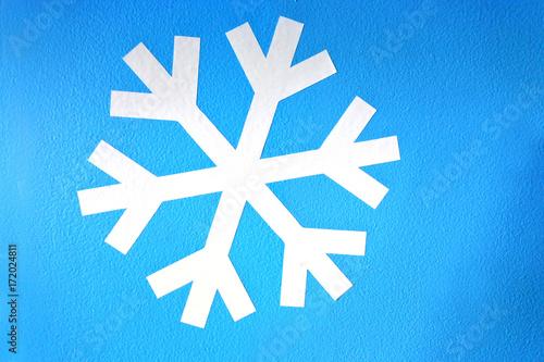 Fototapeta White snowflake on light blue background obraz na płótnie