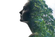 Double Exposure Of Beautiful Woman And Green Leaves.