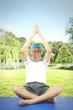 Elderly man practicing yoga in the park