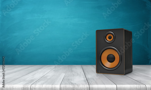 Cuadros en Lienzo 3d rendering of a one black speaker box with orange trim standing on a wooden table in front of a blue background