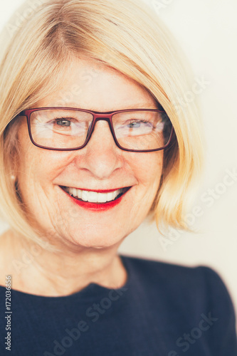 Fototapety, obrazy: Portrait of happy senior businesswoman in glasses
