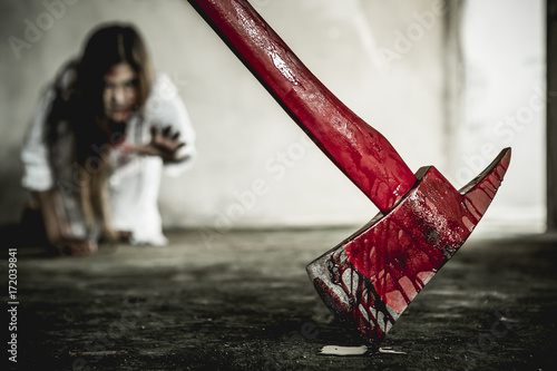 Zombie woman reaching out to grab the ax Wallpaper Mural
