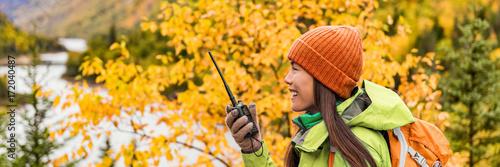 Autumn hiker girl talking on ham radio portable transceiver Canvas Print