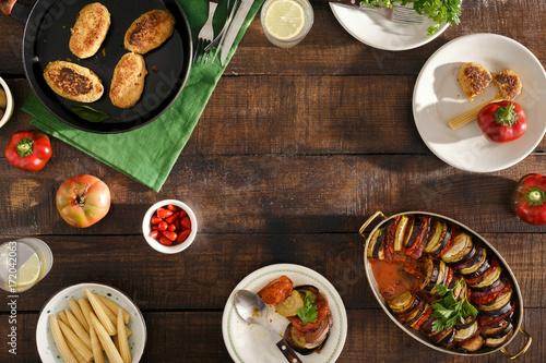 Foto op Aluminium Picknick Frame of Different vegetarian food. Ratatouille, chickpeas cutlets, lemonade, snacks