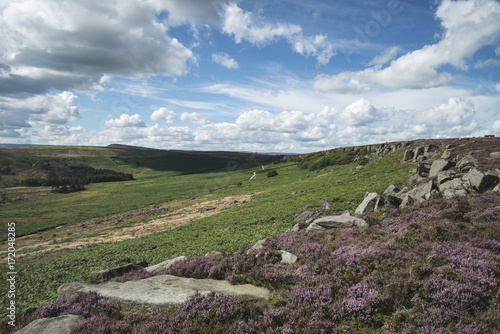Spoed Foto op Canvas Khaki Beautiful vibrant landscape image of Burbage Edge and Rocks in Summer in Peak District England