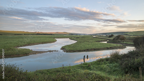 Spoed Foto op Canvas Khaki Beautiful dawn landscape over English countryside with river slowly flowing through fields