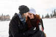 Couple in winter park touching foreheads