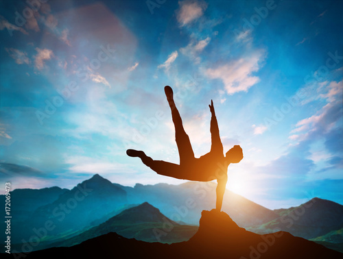 Man jumping over rocks in parkour action in mountains. Fotobehang