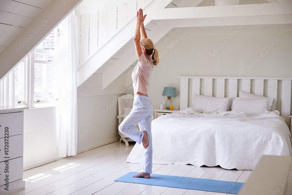 Fototapety, obrazy: Woman At Home Starting Morning With Yoga Exercises In Bedroom